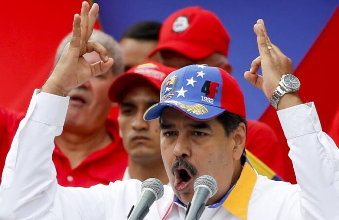 El presidente Nicolás Maduro habla el sábado 23 de marzo de 2019 durante un mitin antiimperialista por la paz, en Caracas, Venezuela. (AP Foto/Natacha Pisarenko)